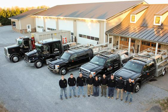 The Byler Builders team and trucks
